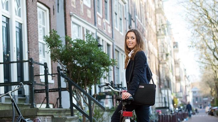 Women in suit posing with her bike