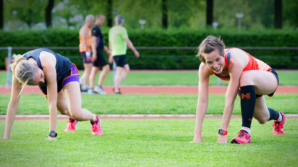 Woman in in a crouching position getting ready to run