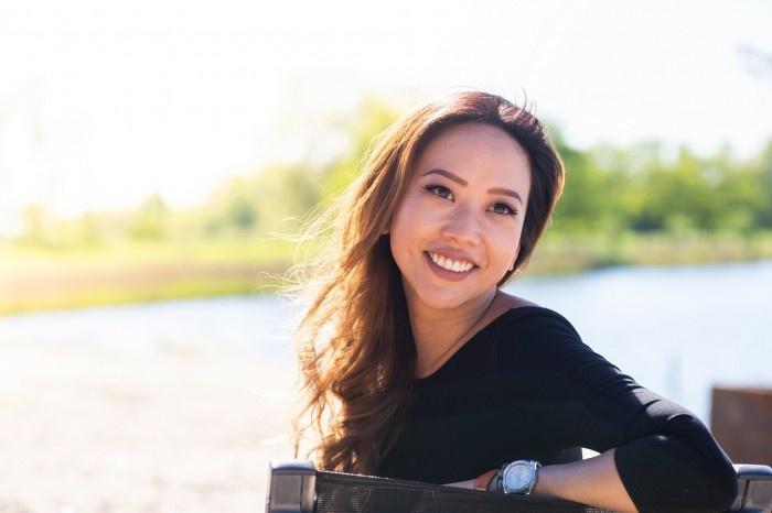 Asian woman posing by the lake