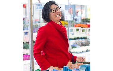Asian woman in glasses and red coat