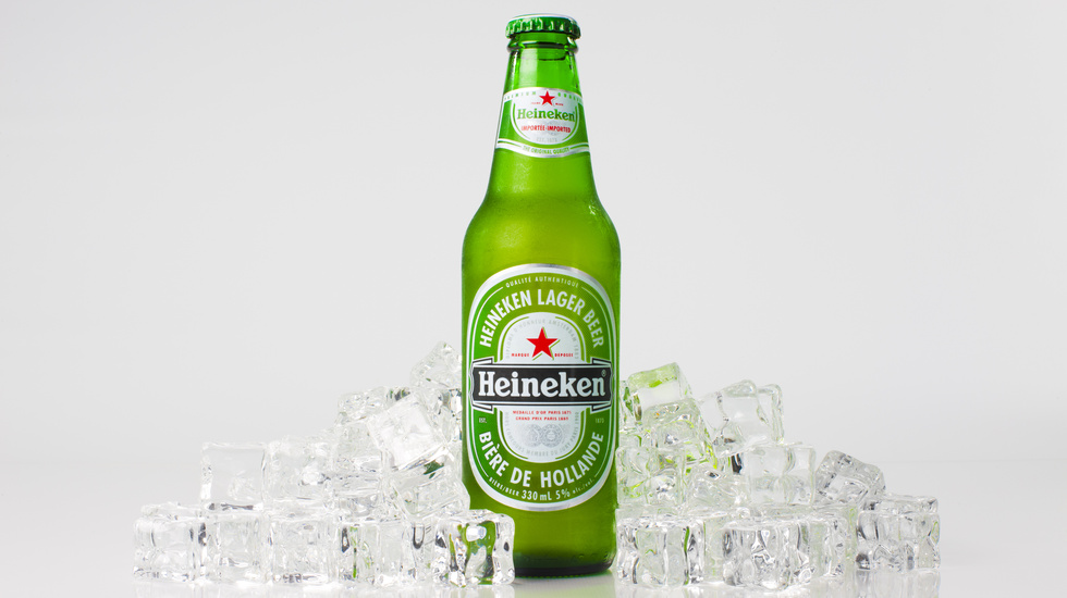 heineken bottle with ice around it