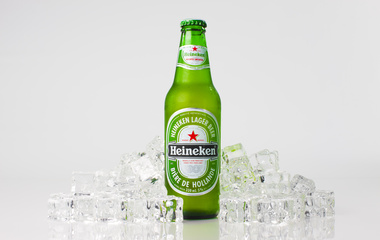 heineken bottle with ice around it