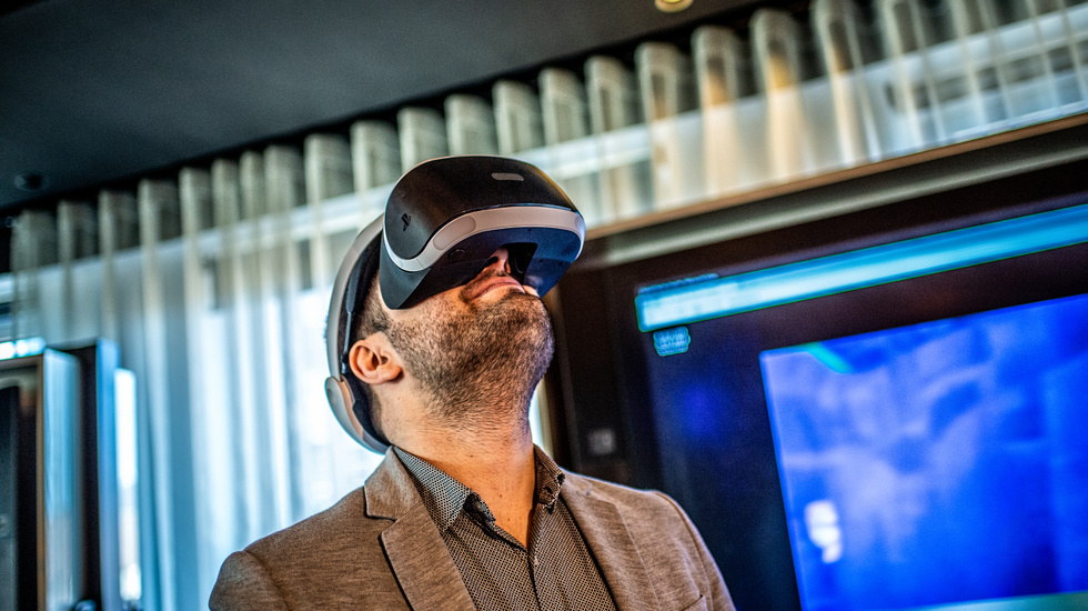 bearded man with VR glass on head
