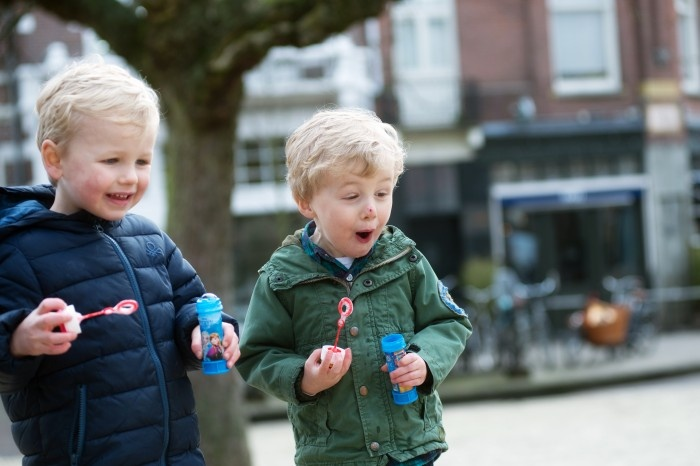 two little boys playing with bubbles