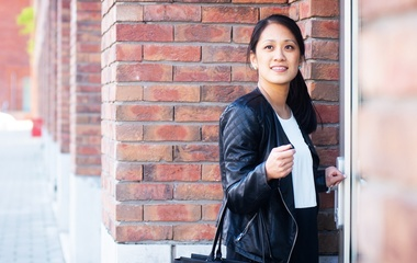 Asian woman in leather jacket