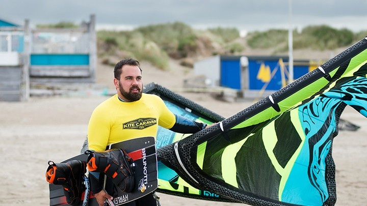 Man posing with kitesurfing gear