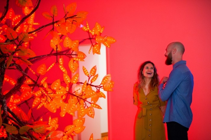 Bearded man and woman in a red room