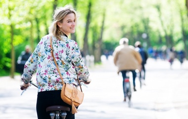 Blond woman biking and looking back