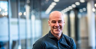 Bald man smiling at camera