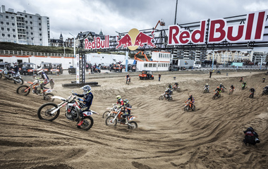 a lot of motorcycles on the beach of Scheveningen driving to win the race
