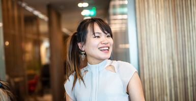 Asian girl smiling looking away from camera