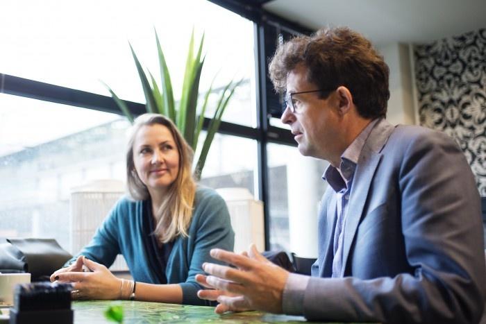 Woman listening to man talking