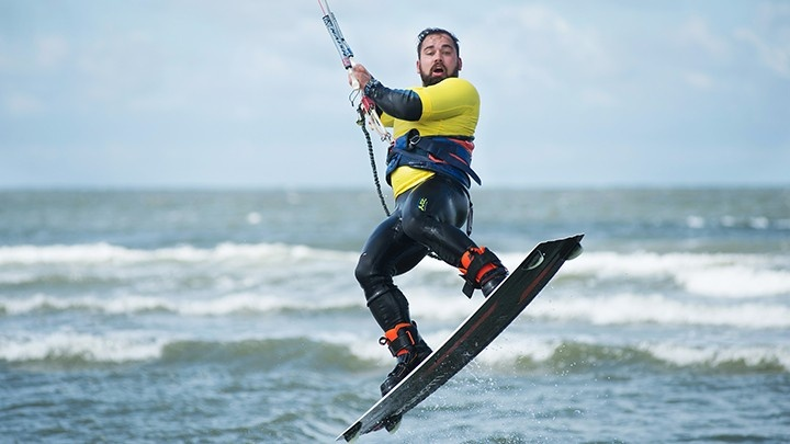 Man doing kitesurfing jump