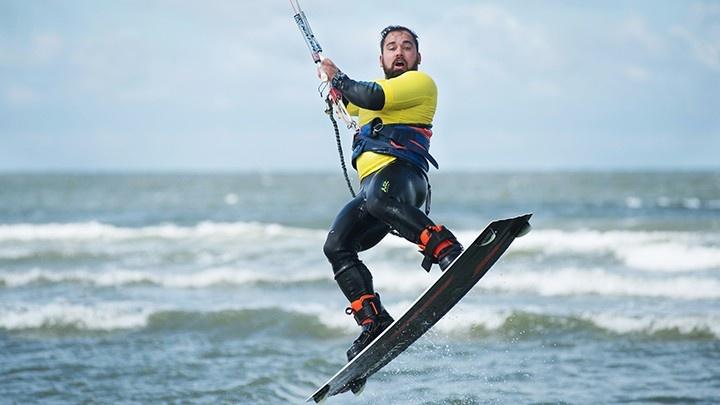 Man doing kitesurfing jump