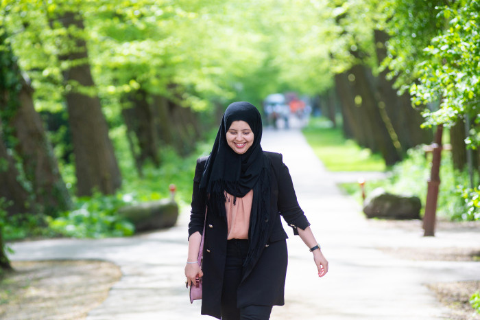 Women in hijab walking in the middle of a park