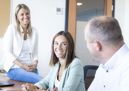 Afbeelding van Action medewerkers in een meeting