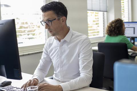 Image of Action employee working